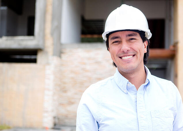 Male engineer in a construction site wearing a helmet